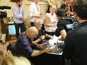 Frank Darabont - Frank Darabont and Drew Struzan signing a Limited Edition poster of 2010 series Walking Dead