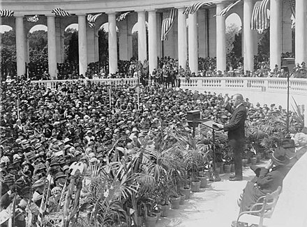 Coolidge addressing a crowd at Arlington National Cemetery's Roman-style Memorial Amphitheater in 1924 Coolidge public address.jpg