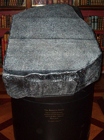 Replica of the Rosetta Stone, displayed as the original used to be, available to touch, in the King's Library of the British Museum Copy of Rosetta Stone.jpg