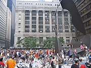 A Critical Mass gathering on the Daley Plaza, with Chicago City Hall in the background and Chicago Picasso on the right