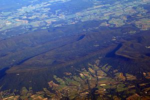 Cumberland Valley - Aerial view of a portion of the Ridge-and-Valley Appalachians forming the northern edge of the Cumberland Valley. Named features in image include Flat Rock, Mount Dempsey, Bloserville, and Bowers Mountain.