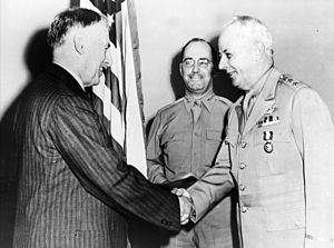 Delos Carleton Emmons - Emmons being awarded the Army Distinguished Service Award by Henry L. Stimson. BG Henry B. Lewis is in the background.
