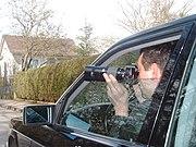 Detektiv mit Teleobjektiv