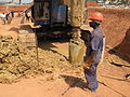 Digging holes for the piles (left the clay that is dug up) (6897506567).jpg