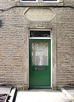 Doorway to South House, Soughgate, Elland. South House, behind the Council Offices, has a door lintel taken from the prison; it is inscribed: 'Whoso keeps the law is wise'.