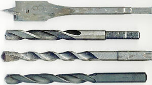 Drill bit - From top to bottom: Spade, lip and spur (brad point), masonry bit and twist drill bits