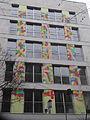 Edifici del carrer provença 212 amb Mural de Harpo.JPG