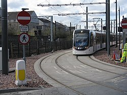 Edinburgh tram passing through Haymarket Yards (geograph 3902690).jpg