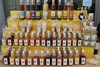 Vinegar - A variety of flavored vinegars on sale in France (bottom rows)