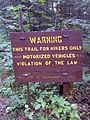 FLT M22 5.9 mi - Sign on logging road near Paradise Hill Rd - panoramio.jpg