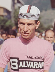 Cyclists wearing a pink jersey.