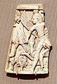 Fenici, placca decorativa in avorio, 900-800 ac ca., da nimrud, combattimento di uomo e grifone.jpg