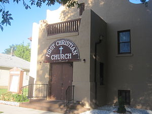 Raton, New Mexico - First Christian Church, in dark pink adobe architecture, is located near the municipal building in Raton; Pastor Ramona Gonzales (2010).