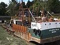 Fishing boat marooned in Palnackie harbour - geograph.org.uk - 237701.jpg