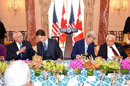 Colin Powell, Canadian Prime Minister Justin Trudeau, Secretary of State John Kerry, and Kissinger in March 2016 Former Secretary Powell, Canadian Prime Minister Trudeau, Secretary Kerry, and Former Secretary Kissinger Chat at the State Luncheon in Honor of the Prime Minister (25050276164).jpg
