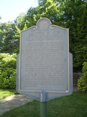 Fort Lincoln (Washington, D.C.) - Battle of Bladensburg historical marker inside the entrance Of Fort Lincoln Cemetery detailing the War of 1812 exploits of the last stand in the American defense against the ensuing British advance by the artillery barrage of Commodore Joshua Barney and his Chesapeake Bay Flotilla of sailors and attached marines before being overwhelmed.