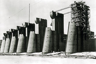 Public Works Administration - Fort Peck Dam in Montana; spillway construction. One of the largest dams in the world, it continues to generate electricity; in July 1936 its construction employed 10,500 workers.