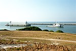 Freedom Star towing Poseidon barge with STS-95 ET (KSC-98PC-0755).jpg