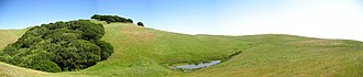 Garin Regional Park - A panoramic view showing a watering hole near a ridge at Garin Regional Park.