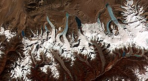 Geography of Bhutan - This image shows the termini of the glaciers in the Bhutan-Himalaya. Glacial lakes have been rapidly forming on the surface of the debris-covered glaciers in this region during the last few decades.