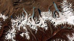 This image shows the termini of the glaciers in the Bhutan-Himalaya. Glacial lakes have been forming rapidly on the surface of the debris-covered glaciers in this region during the last few decades.