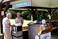 Great Smoky Mountains Association employee assists visitor at Cades Cove Orientation Shelter, June 2013--Warren Bielenberg (40118814812).jpg