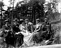 Group of men and women sitting outdoors, May 30, 1898 (WASTATE 2521).jpeg