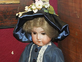 Armand Marseille - Armand Marseille bisque headed doll with composition body, in Rochester Guildhall Museum