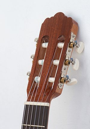 Classical guitar strings - Partial view of nylon strings on a classical guitar with tuning pegs