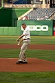 HHS Deputy Secretary Bill Corr throws out the first pitch at HHS Night at the Ballpark.jpg