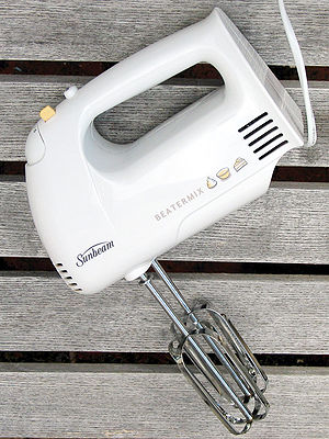 Mixer (cooking) - A handheld electric mixer.