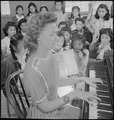 Heart Mountain Relocation Center, Heart Mountain, Wyoming. A fourth grade rhythm class in the grade . . . - NARA - 537164.tif
