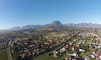 Somerset West - An aerial view of the westernmost residential areas of Somerset West around the Helderberg Mountain.