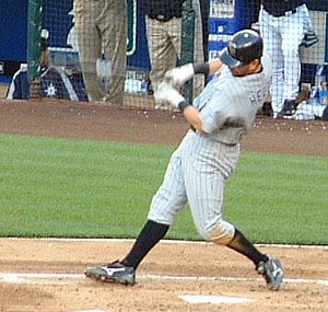 Helton swinging at a pitch during a game again...