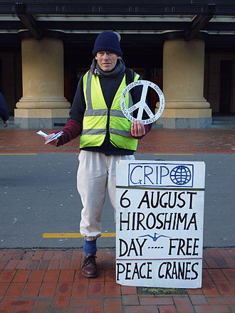 New Zealand nuclear-free zone - An anti-nuclear activist hands out peace cranes in Wellington