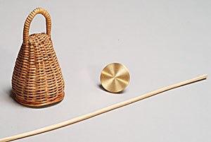 Berimbau - A caxixi, baqueta, and dobrão