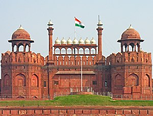 Independence Day (India) - The national flag of India hoisted on the Red Fort in Delhi; hoisted flag is a common sight on public and private buildings on Independence Day.