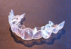 A clear plastic device in the shape of teeth
