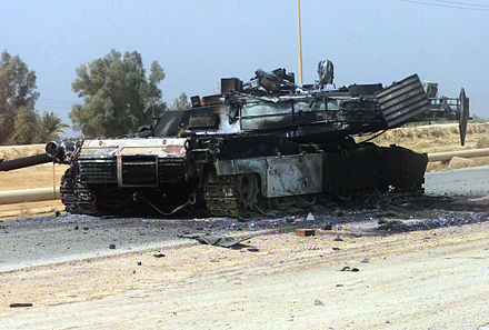 An American M1 Abrams tank destroyed in Baghdad IrakKriegM1A1USA.jpg