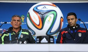 Javad Nekounam - Nekounam with Iran manager Carlos Queiroz during a press conference at the 2014 World Cup