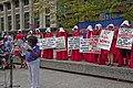 Jacqui Algee from the SEIU Speaks While the Illinois Handmaids Look On Stop Brett Kavanaugh Rally Downtown Chicago Illinois 8-26-18 3480 (43596179104).jpg