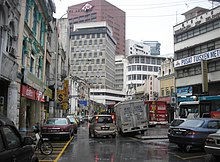 Jalan Tun H S Lee (High Street) in the old town of Kuala Lumpur, featuring a blend of old and new architecture.