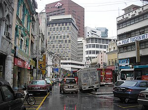 Lat - As a reporter, Lat prowled the streets of 1970s Kuala Lumpur (a typical street in the old town centre pictured), a vastly different environment from the kampung.