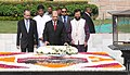 James Alix Michel laying wreath at the Samadhi of Mahatma Gandhi, at Rajghat, in Delhi. The Minister of State for Environment, Forest and Climate Change (Independent Charge), Shri Prakash Javadekar is also seen.jpg