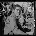 Japanese prisoner awaits questioning by intelligence officer on Guam. - NARA - 520971.tif