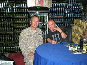 Jason Acuña - Jason 'Wee Man' Acuna poses with a Soldier at the Exchange in Camp Arifjan, Kuwait in 2010 during a USO tour.