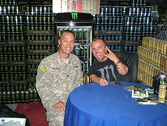 Camp Arifjan - Jason 'Wee Man' Acuna poses with a Soldier at the Exchange in Camp Arifjan, Kuwait in 2010 during a USO tour.