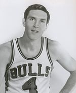 "A man wearing a basketball jersey with ""Bulls 4""."