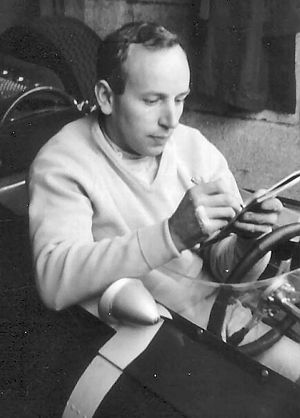 John Surtees - Surtees sitting in his Ferrari signing autographs at Brands Hatch in 1964