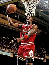 Michael Jordan preparing to dunk the basketball